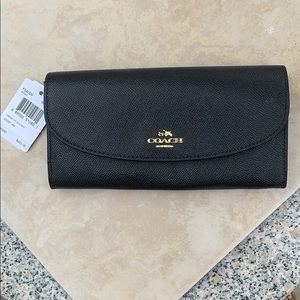 Authentic Coach wallet. New with tags.